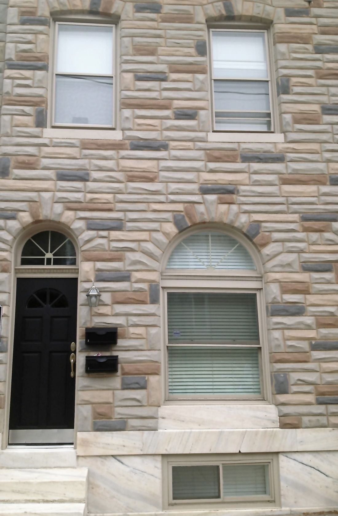 Rowhouse with formstone siding is classic Baltimore...